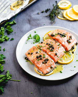 This salmon with capers is oven baked in foil until it's perfectly tender, then topped with a delicious garlic butter sauce
