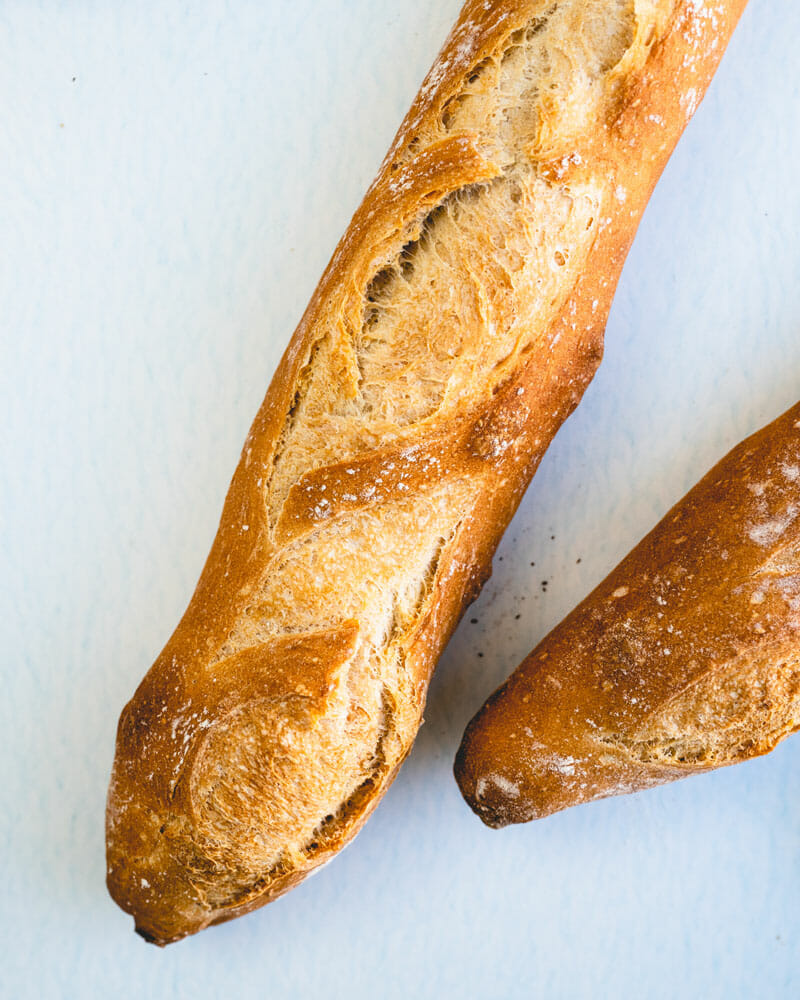 This crusty French baguette recipe is easier to make than you think! Here's a video tutorial showing how to make this classic crusty bread.