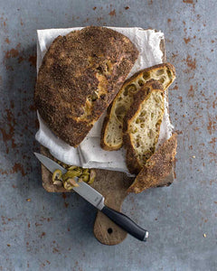 Jim Lahey's no-knead olive bread from Sullivan Street bakery is made with flour, water, yeast, and olives and lets you create the bakery's signature artisan loaf at home with very little effort.