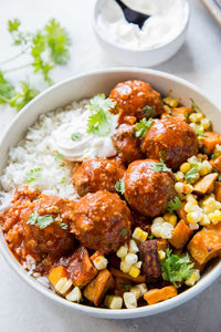 Roasted poblano peppers and crushed tortilla chips create these unique and flavorful Tex-Mex Meatballs in Red Chile Sauce