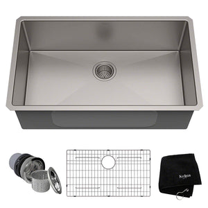 An undermount kitchen sink is installed under the counter, which creates a seamless look as there is not a rim from the sink that sits on the countertop