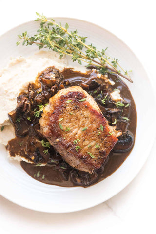 Whole30 + Keto Pork Chops with Bacon Mushroom Sauce Recipe – a low carb, healthy and comforting dinner! Paleo, gluten free, grain free, dairy free, sugar free, clean eating, real food.