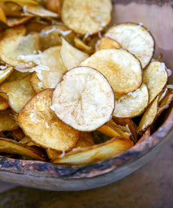 These Manchego potato chips are made by gilding store-bought or homemade potato chips with melted Manchego cheese