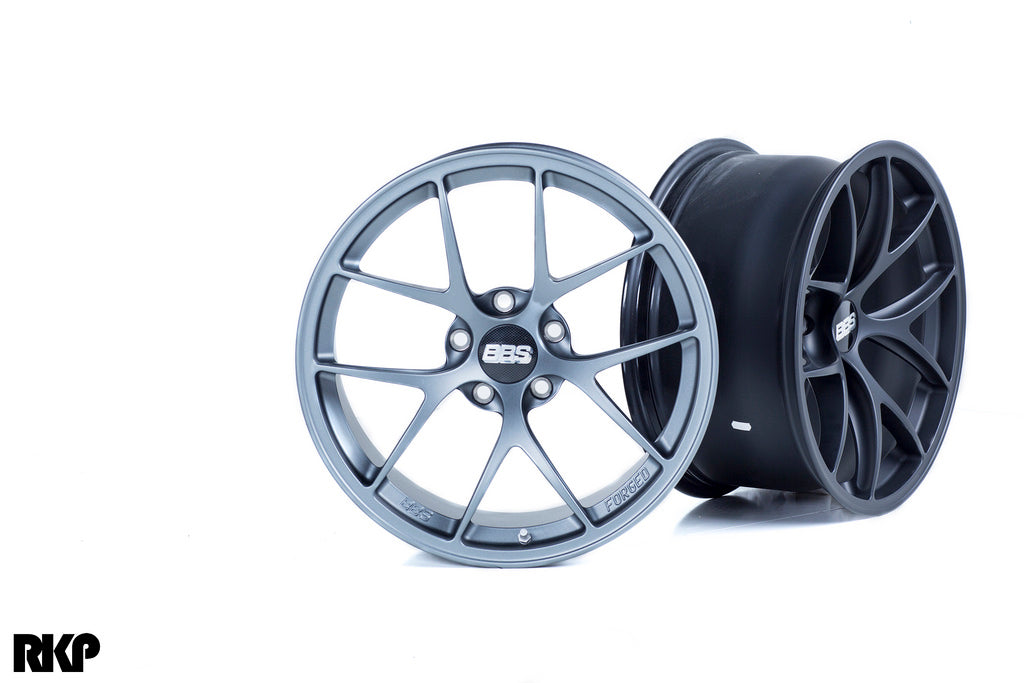 Silver and black BBS wheels against a white background