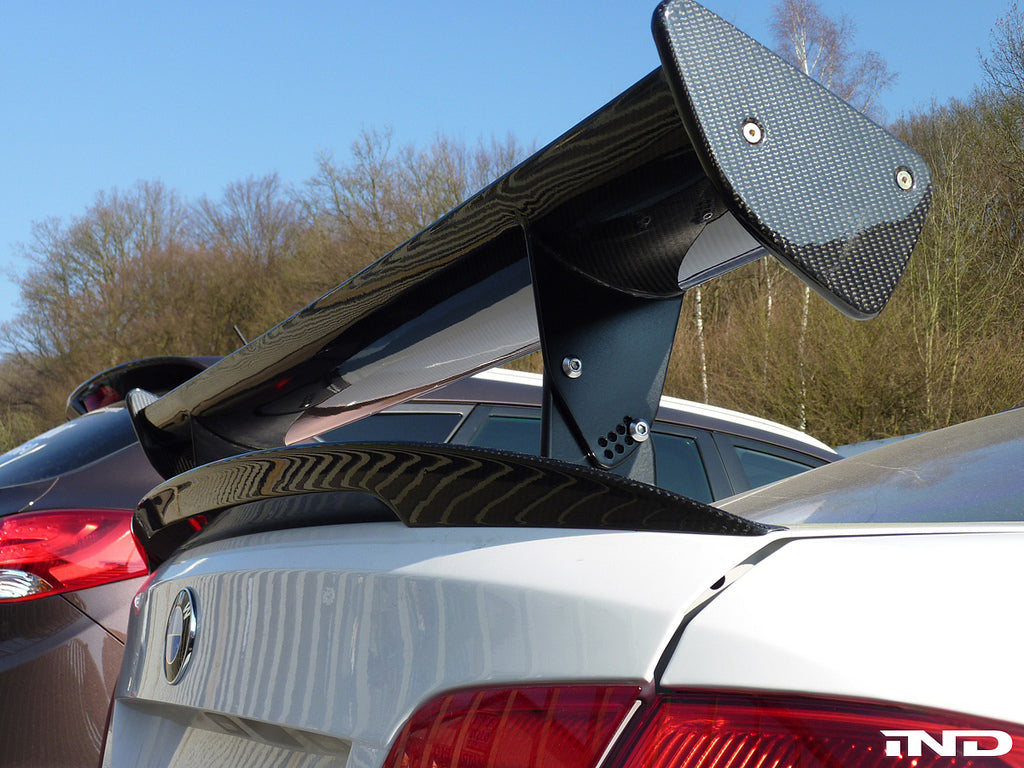 Close up view of black rear wing on a white BMW outside