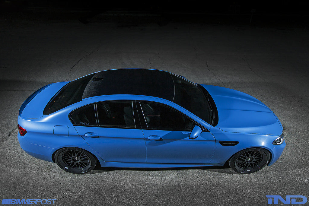 Top down view of blue BMW with black carbon fiber roof