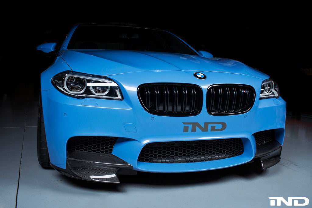 Front of custom blue BMW with M5 McRae Splitters