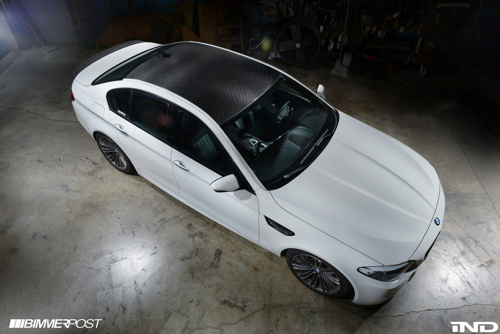 Top down view of white BMW with black carbon fiber roof