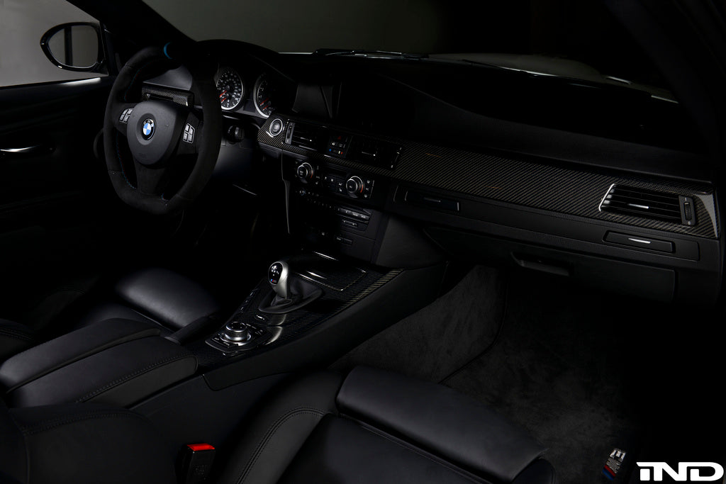 Driver's seat view of BMW with black carbon fiber interior