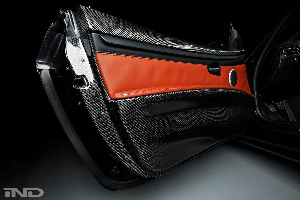 Open black BMW door with orange detail