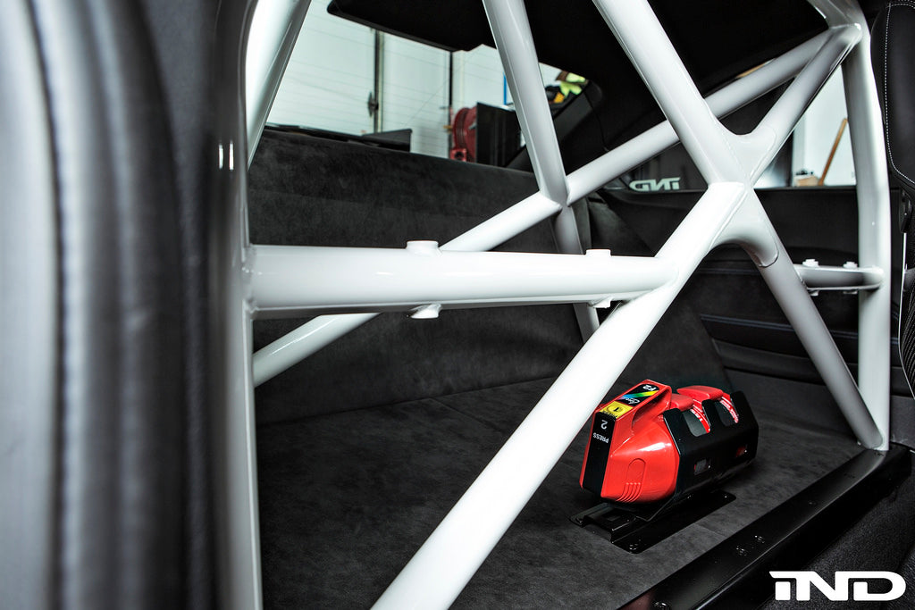 Close up view of white roll bar in trunk of BMW Motorsport M2 car