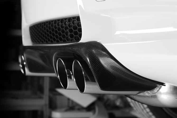 Side view of back of white BMW with black carbon GT sport diffuser