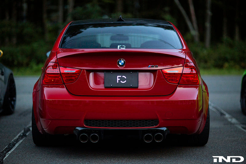 Red BMW with carbon fiber race trunk parked outside