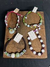 Load image into Gallery viewer, Colors are (pictured clockwise) green cord, burgundy beads, dark brown cord and crimson cord. Each bracelet is one of a kind and features a variety of different jade beads.