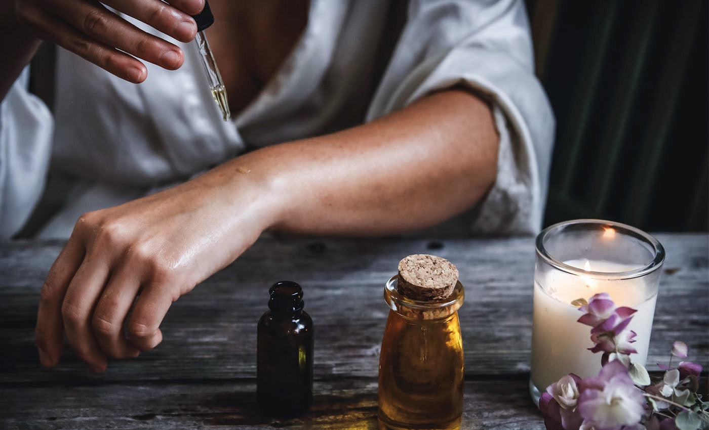 Applying anti-ageing night serum oil to hands for skincare