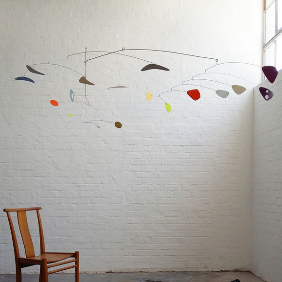 mid century modern decor inspo hanging mobile