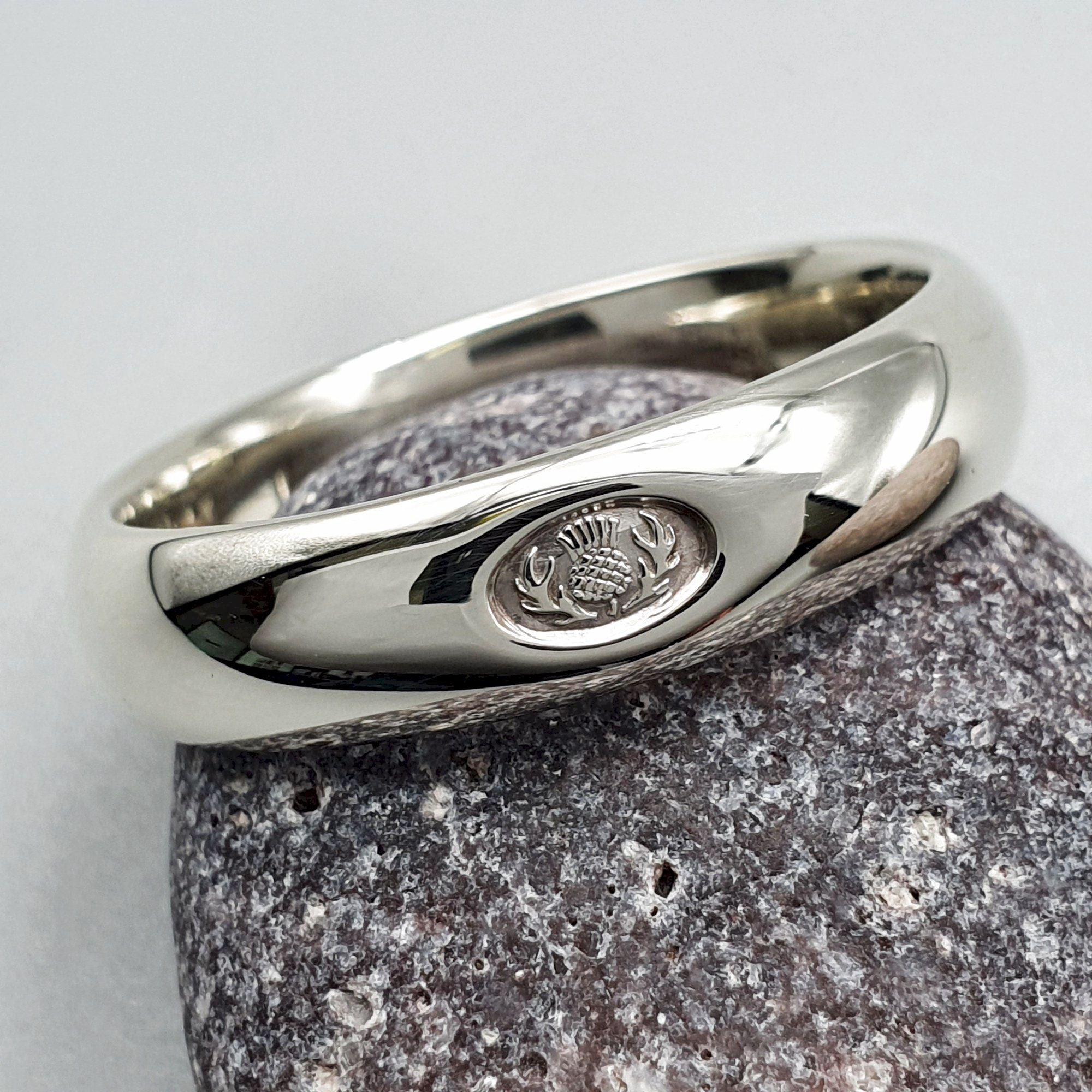 It is just a photo of Silver wedding ring 50mm to 50mm Scottish Thistle medium court band.