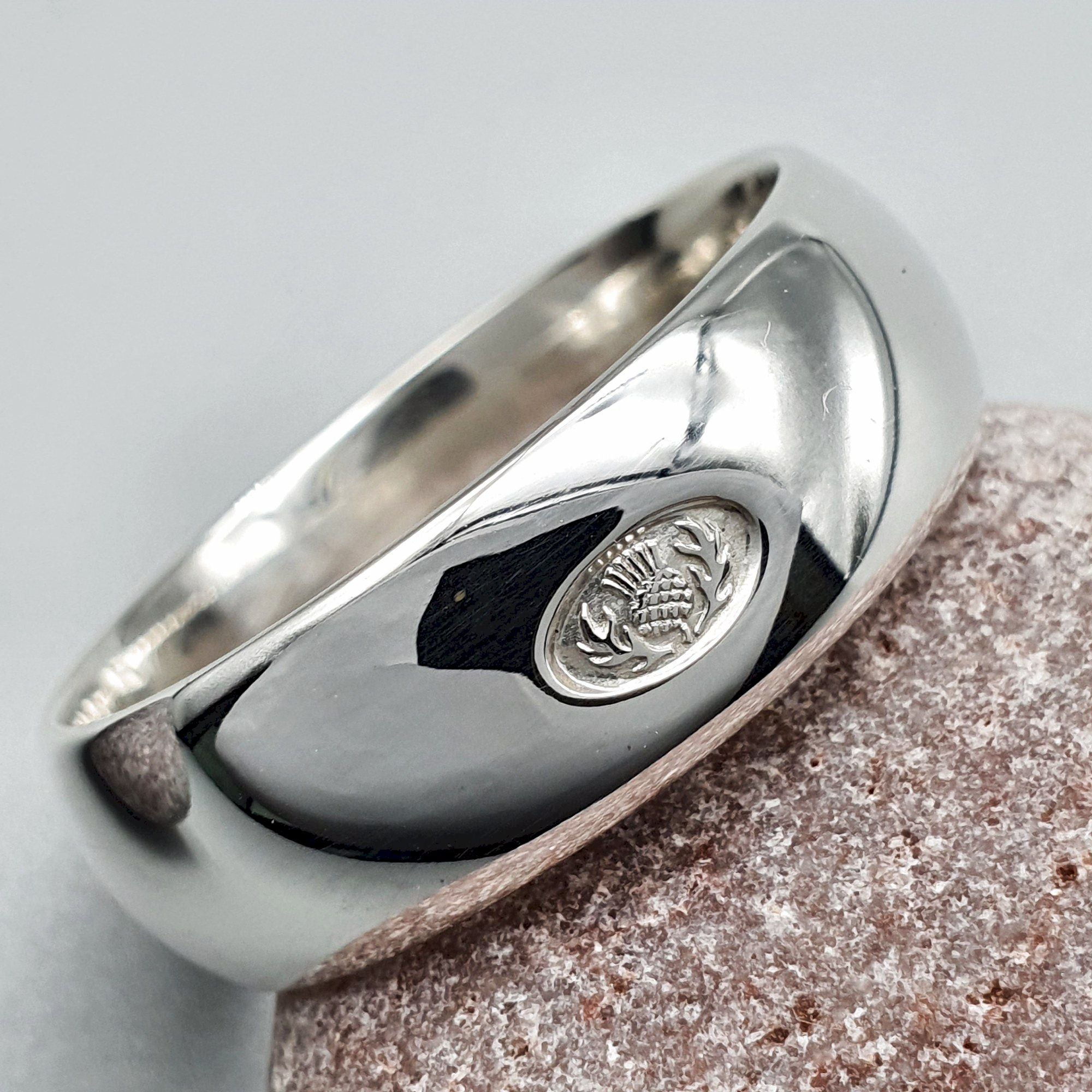It is just a graphic of Wedding ring 50mm to 50mm Scottish Thistle white gold wide band