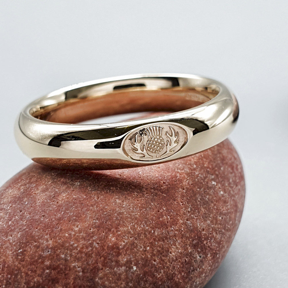 This is a photo of Scottish Thistle yellow gold wedding rings Handmade Scottish
