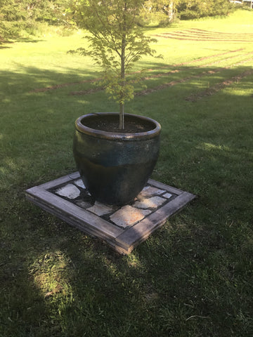 stone pad build for large outdoor pot