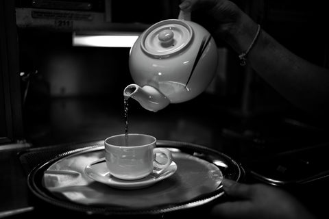 Pouring black tea