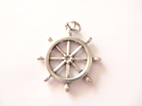 Antique silver ship's wheel charm