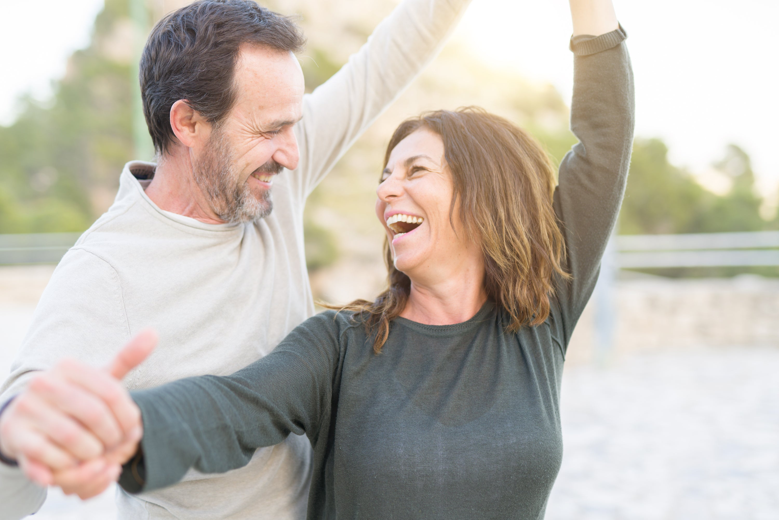 middle-aged couple laughing and dancing