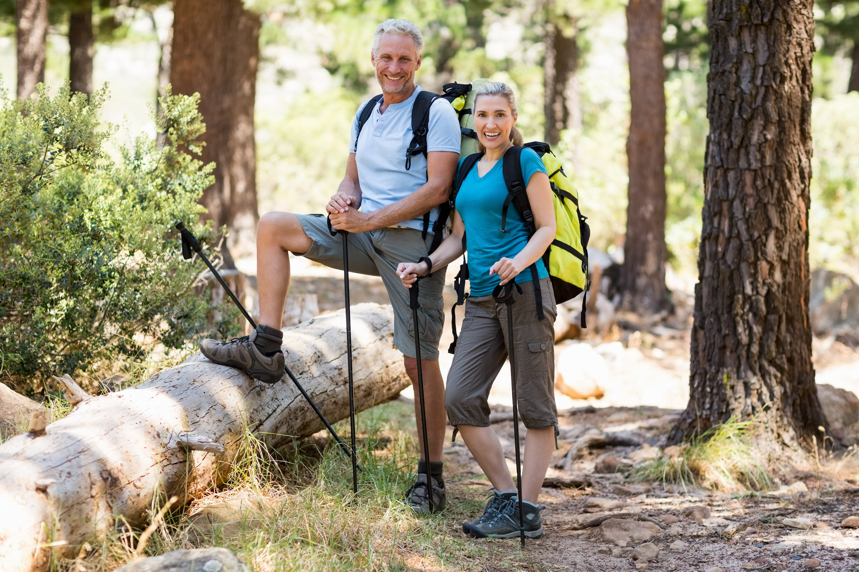 man and woman hiking in forest