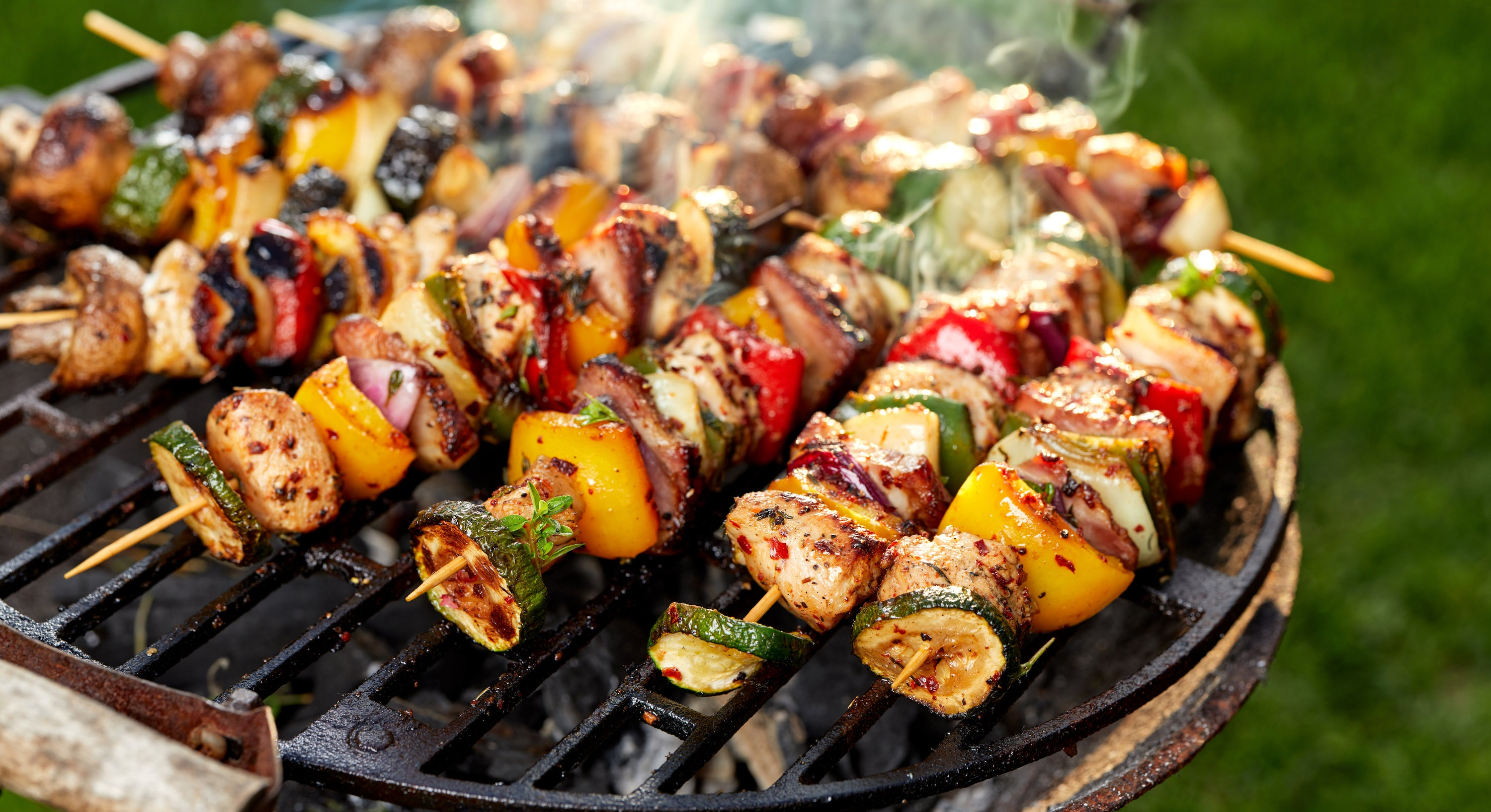 vegetables grilling on skewers with steam