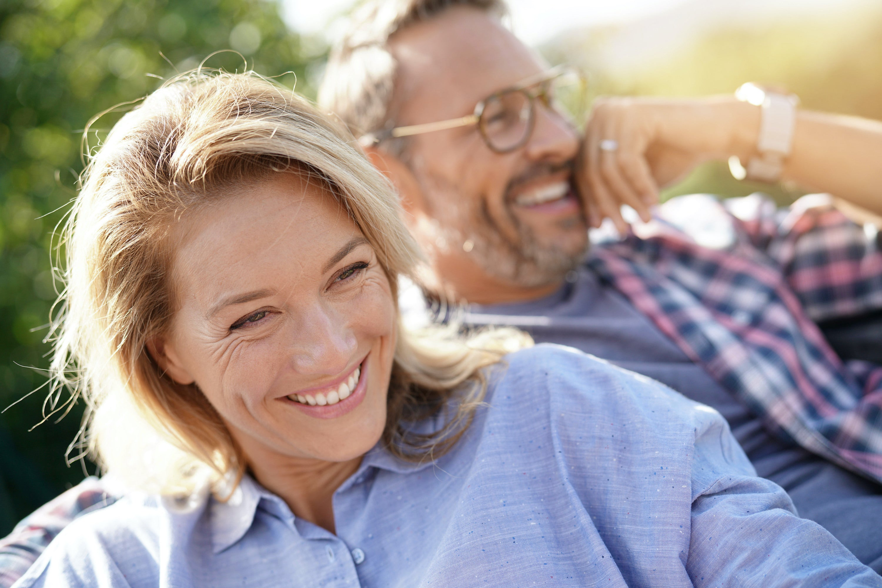 middle-aged man and woman smiling outside