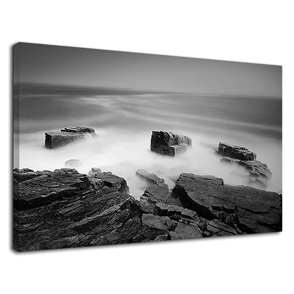 Mist Over The Beach Rocks In Black And White
