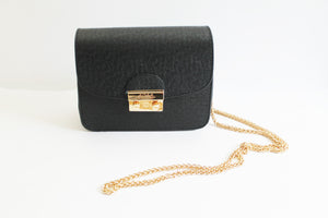 Little Black Clutch by J. Odeh