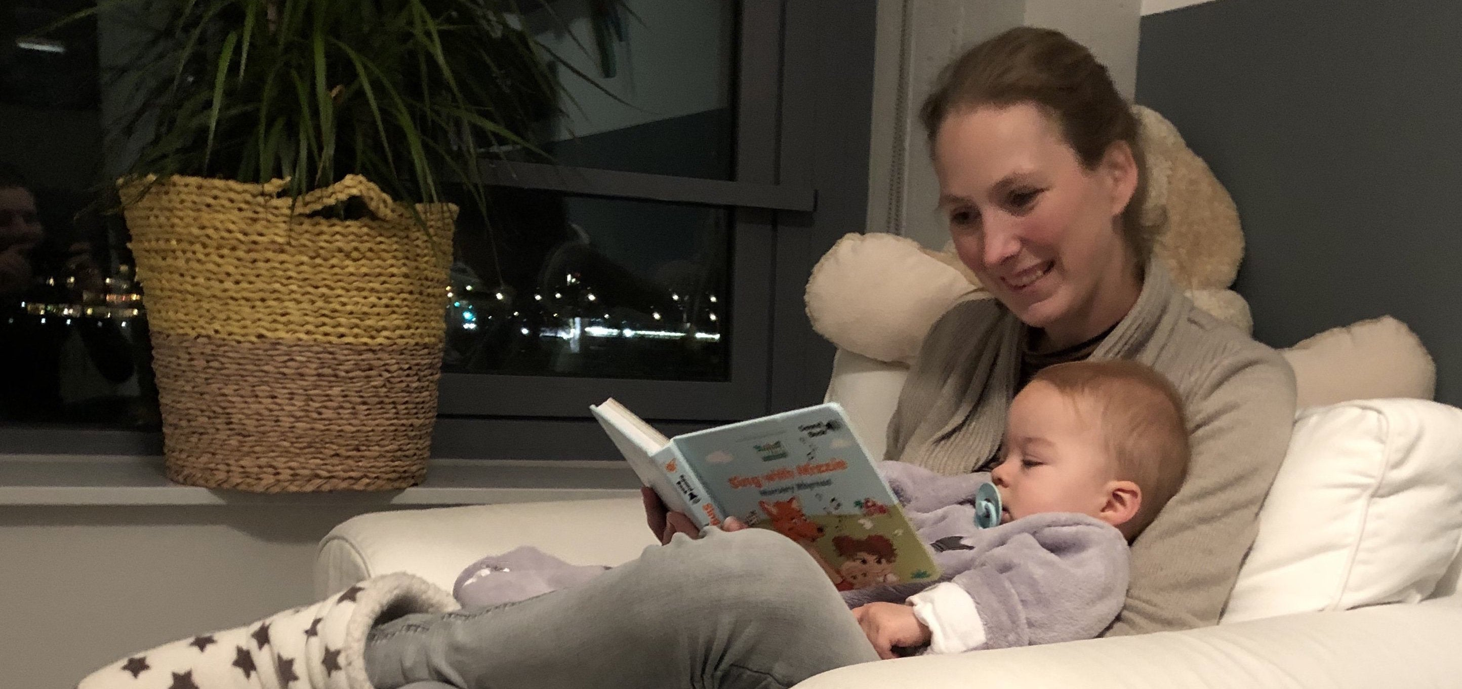 Mom reading to a baby, bedtime reading