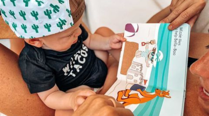Little boy reading with her mom