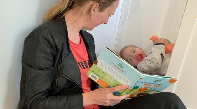 Mom reading to her baby