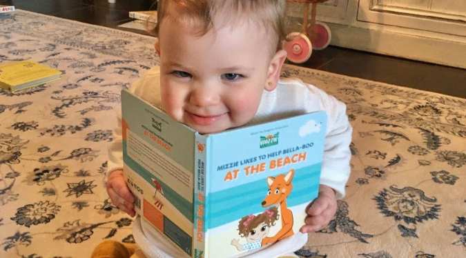 Kid playing with a book