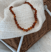 Baby Amber Teething Necklace colour COGNAC