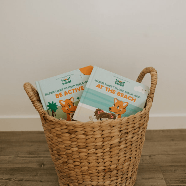 Decorative basket with Mizzie Touch and feel baby board books 'Be Active' and 'At The Beach'
