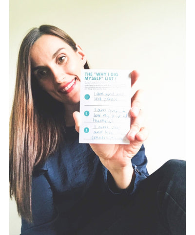 Woman holding self care card