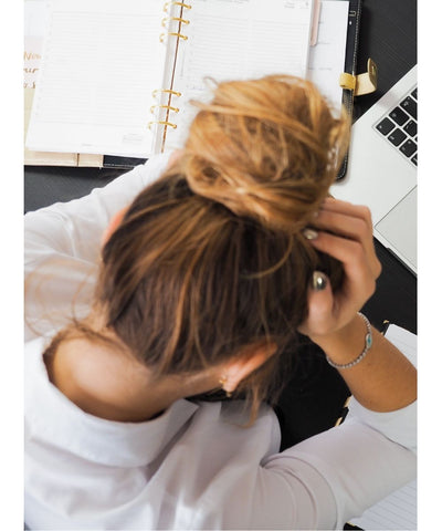 Woman Stressed looking Over a laptop