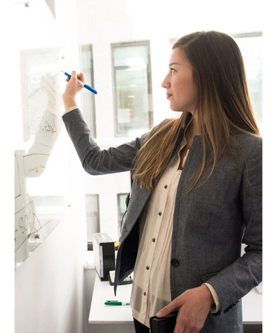 Working Woman, writing on a board suffers from chronic stress