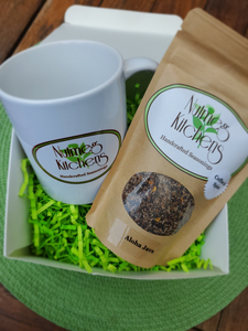 11 ounce Nutmeg Kitchens Handcrafted Seasoing mug with a 4 ounce bag of your choice of our 5 seasoning blends, packaged in a glossy white gift box with bright green crinkle paper