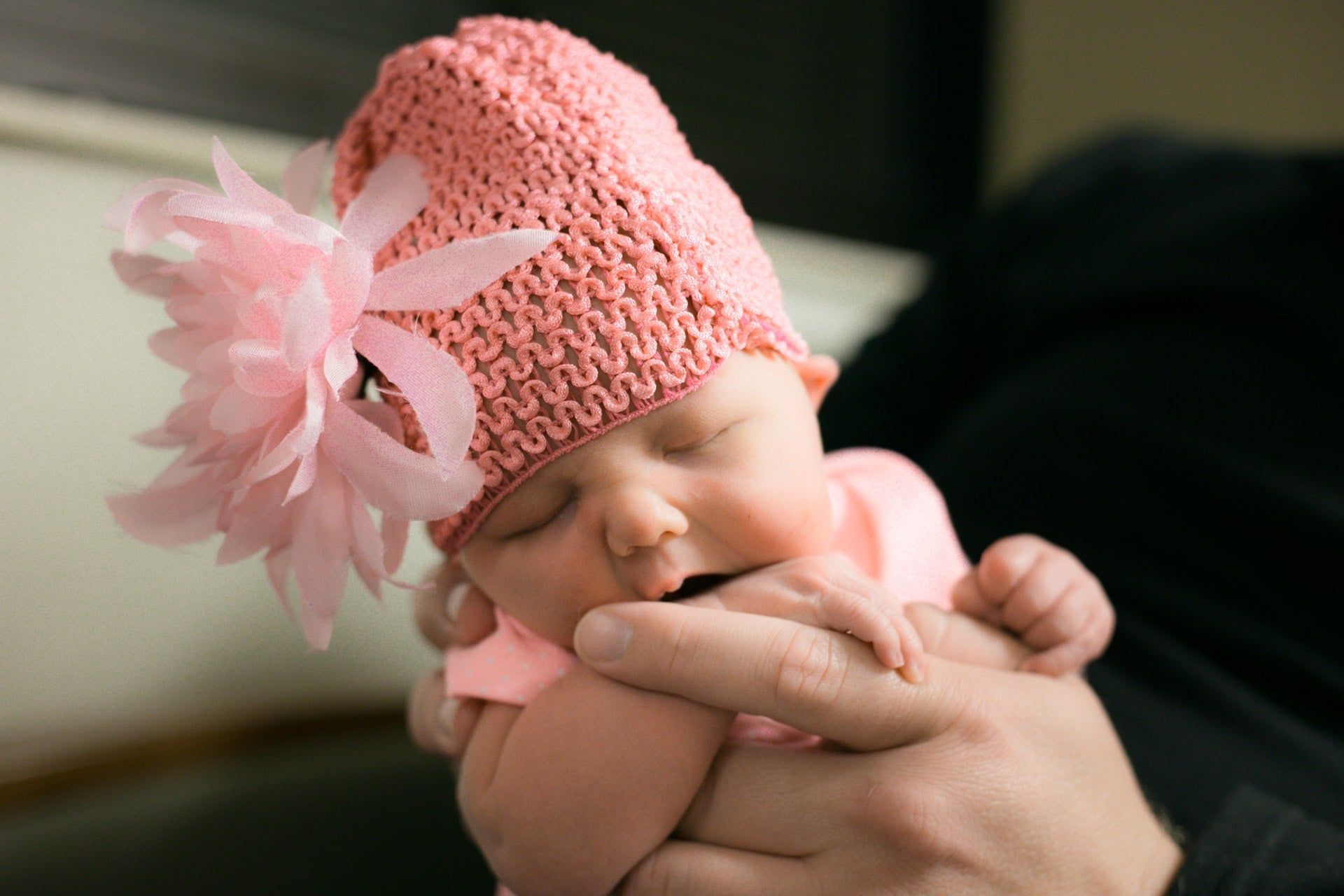 Baby in a pink knit cap