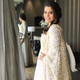 Kajol in our ivory embroidered anarkali set