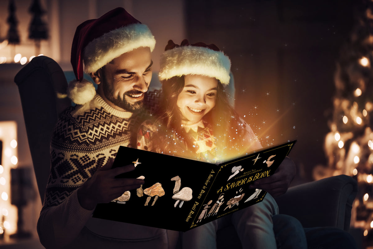 Father and daughter read the new Christmas book together, A Savior is Born, Rocks Tell the Story of Christmas by Patti Rokus