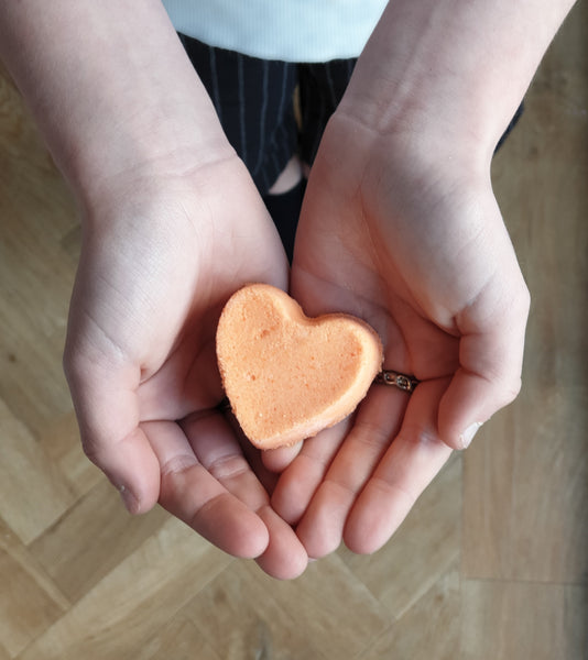 Orange heart shaped bath bomb. Juicy orange fragrance