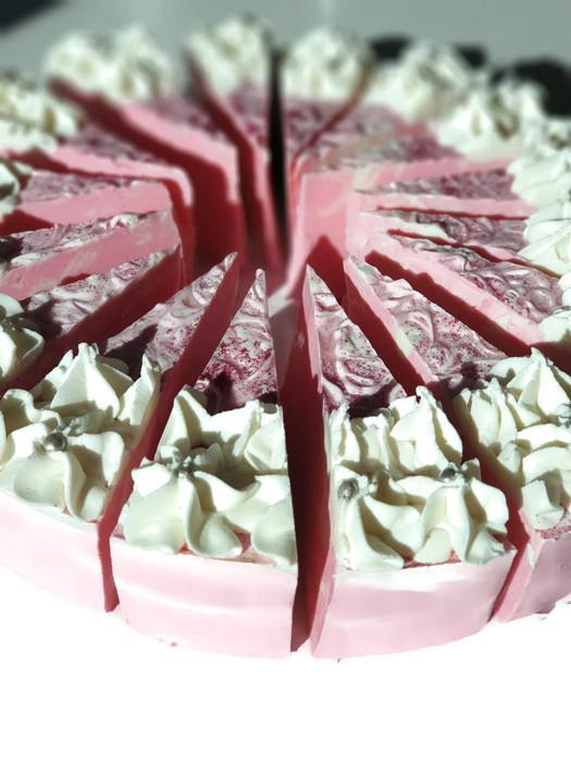 pink swirl cake. piped with white soap icing