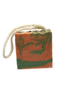 orange and green chunky soap on a rope. fragrance of cactus flower and jade