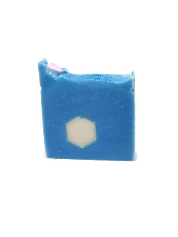 One of a kind blue soap topped with a pink heart and white hexagon embed.  Fragrance white tea