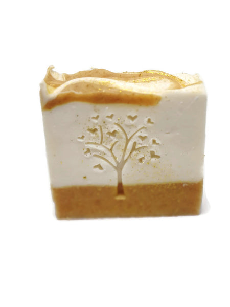Orange Blossom and turmeric soap. Stamped with tree of hearts and sprinkled with gold glitter